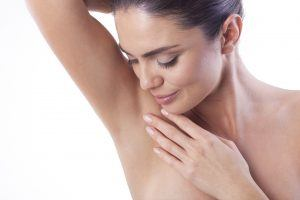 Close up of woman satisfied with the laser hair removal on her armpit