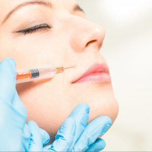 Woman getting a filler injection