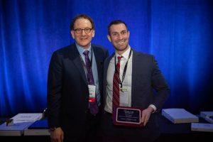 Fellow Dan Callaghan MD receiving his 2019 ASLMS award from Dr. Bernstein