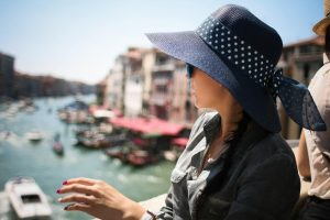 Women wearing a hat to protect her skin from the sun while sightseeing