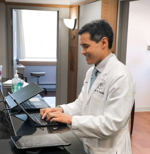 Psoriasis expert Dr. Jeff Sobell entering data on his iPad