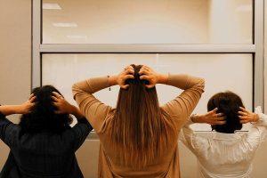 Three women scratching their heads