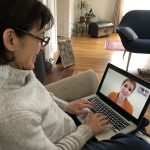 Patient sitting with a laptop and having a telemedicine visit