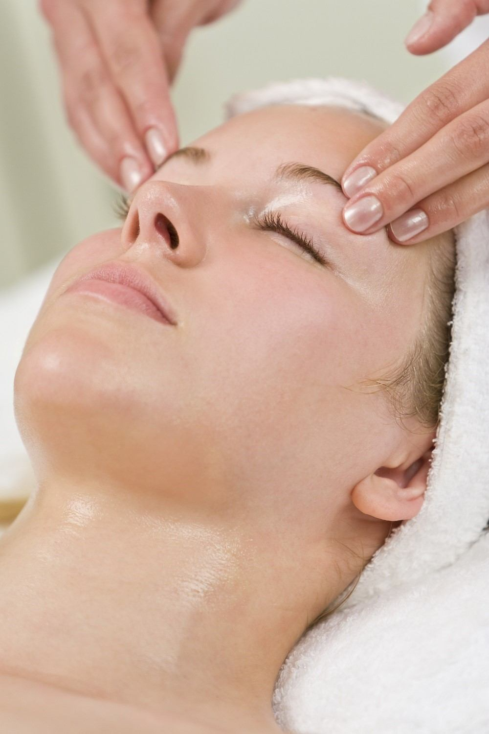 Photo of woman having a facial treatment